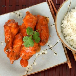 Thai Red Curry Hot Wings Recipe - Red curry paste and sriracha bring Thai flavors to these spicy chicken wings which you can season to your particular taste.