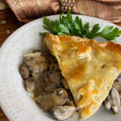 Elegant Mushroom Pie Recipe Recipe - Sauteed mushrooms in a thick and creamy sauce with Marsala wine is baked in a puff pastry shell for an easy yet elegant dinner.