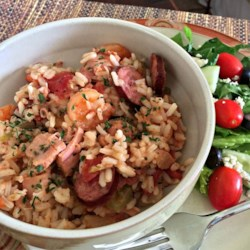 Simple Slow Cooker Jambalaya Recipe - Smoky, spicy andouille sausage, chicken thighs, and shrimp cook up in a rice and vegetable mixture for a crowd-pleasing one-pot meal.