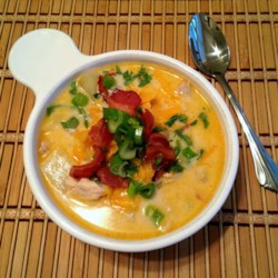 Southwestern Chicken and Corn Soup Recipe - This creamy chicken and corn soup uses lots of spices like cumin and chili powder plus jalapenos and Cheddar cheese for a taste of the Southwest.