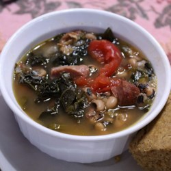 SoCal Greens and Black Eyed Pea Soup Recipe - Traditional New Year's food from the South--black-eyed peas, ham hocks, and greens--are transformed into a hearty, warming soup with the addition of chicken broth, tomatoes, and spices.