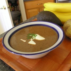Black Bean Soup II Recipe - This easily prepared soup is made with canned black beans which are pureed with sauteed onion, garlic and green bell pepper.