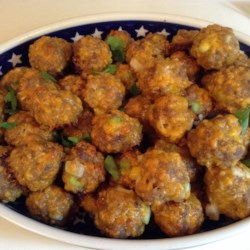 Sausage Cheese Balls Recipe - These sausage balls were a hit at our Christmas party this year.  I accidentaly used low-fat cheese in the recipe and couldn't tell the difference. No frying necessary, they bake beautifully.