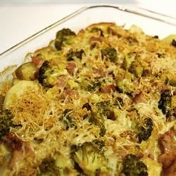 Absolute Best Potato Casserole Recipe - Potatoes, ham, and cauliflower are layered, and baked with a delicious Swiss and Cheddar cheese sauce.