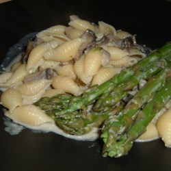 Pasta Shells with Portobello Mushrooms and Asparagus in Boursin Sauce Recipe - From my friend Tasneem - an easy recipe to prepare, resulting in a downright sophisticated dish. Asparagus and pasta are tossed with a cheesy mushroom sauce.