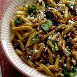 Quick Greek Pasta Salad with Steak Recipe - This rich, delicious pasta dish combines succulent rib-eye steak pieces with whole wheat penne pasta in a sun-dried tomato and spinach sauce.