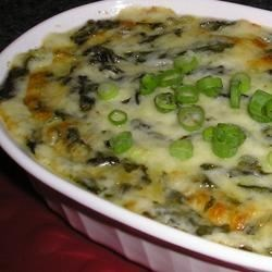 Hot Cheesy Spinach Dip Recipe - Here's a hot, creamy spinach dip made with white wine and plenty of mozzarella cheese. It's better than anything served in a restaurant. For extra excitement, add a can of artichokes, crabmeat or shrimp. Serve with tortilla chips, assorted crackers or bread.