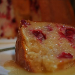 Ultimate Cranberry Pudding Cake Recipe - An absolutely delicious cranberry Bundt cake. The hot butter sauce is to die for. Great for the holidays!