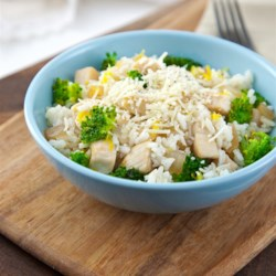 Lemon-Parmesan Chicken and Rice Bowl Recipe - This quick and delicious meal will be loved by your whole family thanks to it being cheesy, lemony, and crunchy!