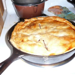 Iron Skillet Apple Pie Recipe - Cast-iron skillet apple pie is easy to prepare using refrigerated pie crust, Granny Smith apples, and buttery brown sugar base.