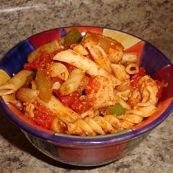 Quick and Easy Chicken and Tomato Pasta Recipe - A quick, easy, and delicious chicken and tomato pasta dish with mushrooms and black olives. It's perfect for hectic weeknights and makes great lunch leftovers, too.