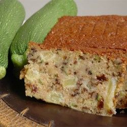 Zucchini Pineapple Bread II Recipe - A touch of the Hawaiian Islands highlights this sweet zucchini-nut bread.  No spices are called for;  the rich sweetness of pineapple and raisins provide ample interest.