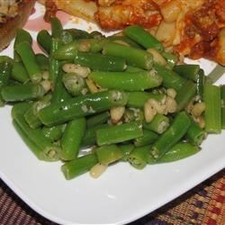 Green Beans for a Special Occasion Recipe - Green beans are tossed with garlic and pine nuts in this delightfully simple side dish!