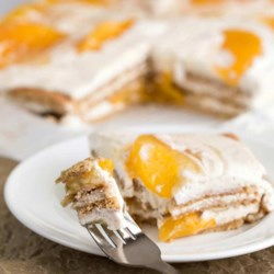 Peach Icebox Cake Recipe - Layers of peaches and a creamy filling on a graham cracker crust make an easy and delicious chilled dessert.