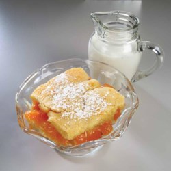 Apricot Shortbread Recipe - Apricot fruit filling is baked between rich, buttery layers for a delightful tea time snack.