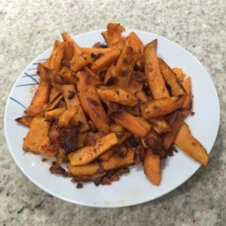 Bacon-Flavored Sweet Potato Fries Recipe - Bacon-flavored sweet potato fries coated in paprika and salt are a quick and easy snack or tasty side dish to any sandwich.