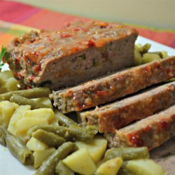 Mushroom and Swiss Burger Meatloaf Recipe - This meatloaf tastes like a mushroom Swiss burger because it has a layer of  cheese and mushrooms hidden inside.