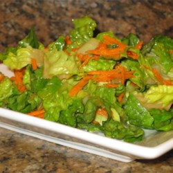 Orange Citrus Vinaigrette Recipe - Quickly make your own salad dressing with this recipe and a handful of ingredients: olive oil, rice wine vinegar, orange juice, Dijon mustard, honey, garlic, and cilantro.