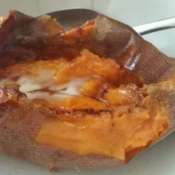 Camotes al Horno (Baked Yams) Recipe - A rich, warm, buttery sweet yam is a delightful side dish as well as a comforting treat all on its own. This simple recipe will have a yam on your plate in no time at all.