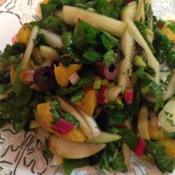 Fennel Apple Salad Recipe - Swiss chard is mixed with a vibrant combination of fennel, apple, clementine orange sections, and kalamata olives. The citrus-Dijon dressing is easy to whisk up.