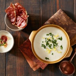 Garlic Soup with Crispy Prosciutto Recipe - This creamy garlic soup with chicken broth and herbs is topped with crispy prosciutto and a pinch of lemon zest.