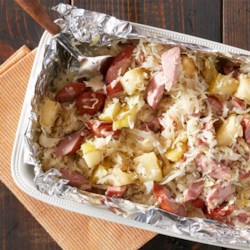 Roasted Sausage and Sauerkraut Recipe - Kielbasa, sauerkraut, onion, caraway, and apples roasted in foil make a quick and easy Eastern Europe-inspired dinner.