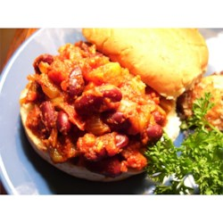 Unsloppy Joes Recipe - The filling - kidney beans and lots of celery, carrots, green pepper tomatoes, and onions flavored with chili pepper and vinegar. When this is hot and savory, spoon into hollowed out Kaiser rolls and dig in.
