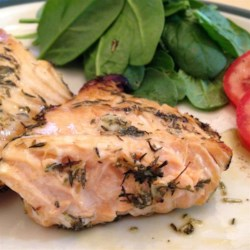 Morgan's Grilled Fish Recipe - A great summertime recipe for grilled salmon filets. These are marinated in lemon and herbs. Very light and flavorful. Grilled onions would be an excellent addition!