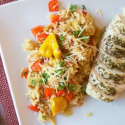 Orzo-Rice Pilaf with Patty Pan Squash and Bell Pepper Recipe - This orzo and brown rice basmati pilaf with chicken broth, pattypan squash, red bell pepper, fresh thyme, and Parmesan cheese makes a delicious anytime side dish.