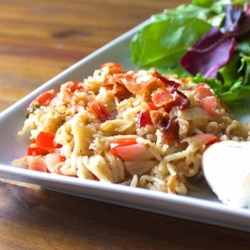 Bacon, Rice and Vermicelli Pilaf Recipe - Rice and vermicelli are sauteed in butter with onions and bell pepper, simmered in Swanson(R) Chicken Broth, and topped with bacon crumbles.
