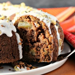 Applesauce Rum-Raisin Cake Recipe - This easy cake is made with whole wheat flour and applesauce, along with rum-soaked raisins and chopped walnuts.