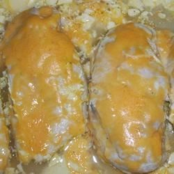 Sour Cream Marinated Chicken I Recipe - Lemon-mustard marinade permeates chicken cooked in a sour cream sauce and topped with a little melted Cheddar for the tangiest, tastiest dish going.