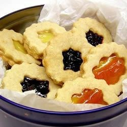 Linzer Torte Cookies Recipe - These are a cookie version of the classic Austrian dessert. You can make them as cookie bars with a lattice top, or use cookie cutters.