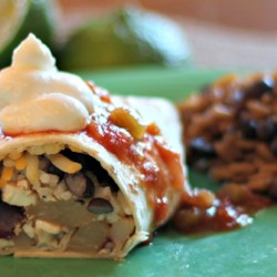 Vegetarian Jamaican Jerk Burrito Recipe - Tofu, cheese, rice, black beans, pineapple, jicama, and a Jamaican jerk sauce fill a flour tortilla, only to be topped with hot salsa and sour cream for a Mexican-Jamaican fusion delight.