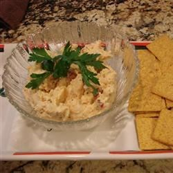 Creamy Summer Crab Dip Recipe - This creamy imitation crab dip is made with cream cheese, mayo, and sour cream.  A lovely cold and creamy crab dip. Fantastic served with butter flavored crackers. We never have any left!