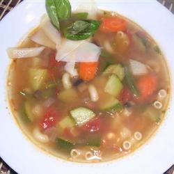 Pistou Soup Recipe - Homemade tomato-basil pesto is stirred into this hearty vegetarian soup of beans, zucchini, and potatoes.