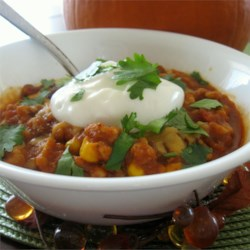 Pumpkin Turkey Chili Recipe - A chili for autumn! Turkey, pumpkin, and traditional chili ingredients go together well in this spicy concoction.