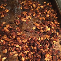 Perfect Pumpkin Seeds Recipe - Save the pumpkin seeds from Halloween decorating and roast them with smoky, spicy flavors, including bacon drippings and cayenne pepper. The seeds soak in flavorings overnight, and broil in just a few minutes.