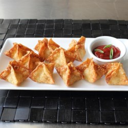 Chef John's Crab Rangoon Recipe - These deep-fried crab and cream cheese wontons contain just as much crab meat as cream cheese. They're served with a spicy sweet-and-sour dipping sauce.
