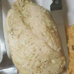 Garlic Chicken Breasts Recipe - Chicken breasts are marinated in a tangy garlic sauce and baked for a quick weeknight dinner.