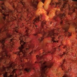 Baked Ziti Plus Recipe - Standard baked ziti with sausage, peppers, and onions added to the sauce and topped with mozzarella cheese is a warm comforting meal the will surely make your family happy.