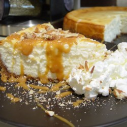 Caramel Pecan Cheesecake Recipe - A simple cheesecake with a spiced crust and a caramel pecan topping.