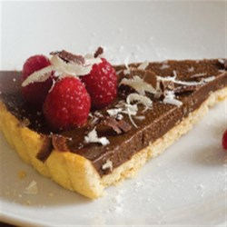 Hazelnut Fudge Crostata Recipe - This chocolate and hazelnut crostata makes an impressive dessert topped with fresh raspberries and little mint leaves.