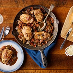 Pork Chops Smothered in Onions and Mushrooms Recipe - Smothered in Onion and Mushrooms, this delicious pork inspired meal is sure to be a keeper. Simmering bacon and pork chops together and stirring in stock, vinegar and garlic to complete.