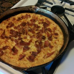 Scalloped Corn and Bacon Casserole Recipe - A baked corn casserole has crumbled bacon for extra flavor.