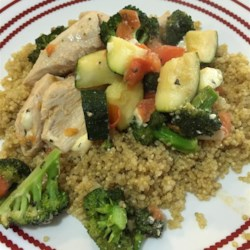 Chicken with Quinoa and Veggies Recipe and Video - Chicken breast meat, zucchini, tomato, fresh basil, and feta cheese make a delicious main dish when served over hot quinoa that's been simmered in chicken broth.