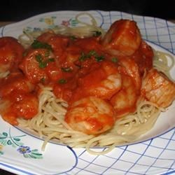 Shrimp, Clams, and Scallops Pasta Recipe - Seafood combined with a savory red sauce over pasta will tease your senses! I serve mine with fresh garlic bread and a green garden salad. YUM!