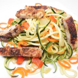 Vinaigrette Chicken and Vegetables Recipe - Spiral-sliced zucchini and carrots combine with chicken thighs in a quick and easy one-pan dinner. Vinaigrette dressing adds a bright note.