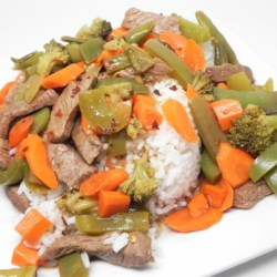Spicy Sweet Steak Stir Fry Recipe - Thin strips of New York steak are stir-fried with broccoli, snap peas, carrots, and bell pepper in a sweet and spicy Chardonnay wine sauce.