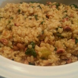 Vegetarian Hoppin' John Recipe - Black-eyed peas and rice come together to make Hoppin' John, the traditional and tasty way to bring luck the New Year.